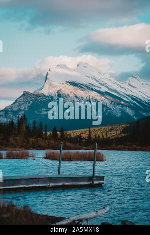 Vermillion Lake located in Banff, AB, Canada. The sunset and the mountain behind casting a shadow on Mount Rundle made the view even more scenic. - Stock Photo