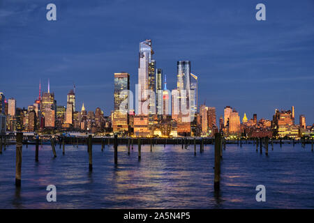 Buildings of Midtown Manhattan Illuminated at Night as Viewed from Weehawken, New Jersey - Stock Photo
