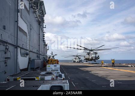 190914-N-MY922-1066 ATLANTIC OCEAN (Sept. 14, 2019) A CH-53E Super Stallion, assigned to the Blue Knights of Marine Medium Tiltrotor Squadron (VMM) 365 (Reinforced), takes off from the flight deck of the amphibious assault ship USS Bataan (LHD 5), Sept. 14, 2019. Bataan is homeported at Norfolk Naval Station. (U.S. Navy photo by Mass Communication Specialist 2nd Class Kaitlin Rowell) - Stock Photo