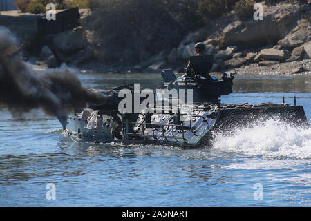 U.S. Marines with Assault Amphibian School Battalion, Training Command, conduct basic water driving training in an AAV-P7/A1 Amphibious Assault Vehicle at the 21 Area boat basin on Marine Corps Base Camp Pendleton, California, Oct. 21, 2019. Marines training to be AAV crewmembers at the school train in basic land driving and tactics, basic water driving, and basic gunnery training over 55 training days. The battalion also trains AAV mechanics, officers, and crew chiefs.   (U.S. Marine Corps Photo by Lance Cpl. Andrew Cortez) - Stock Photo