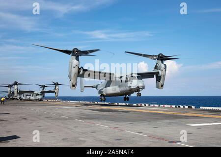190914-N-MY922-1041 ATLANTIC OCEAN (Sept. 14, 2019) An MV-22B Osprey, assigned to the Blue Knights, of Marine Medium Tiltrotor Squadron (VMM) 365 (Reinforced), takes off from the flight deck of the amphibious assault ship USS Bataan (LHD 5), Sept. 14, 2019. Bataan is homeported at Norfolk Naval Station. (U.S. Navy photo by Mass Communication Specialist 2nd Class Kaitlin Rowell) - Stock Photo