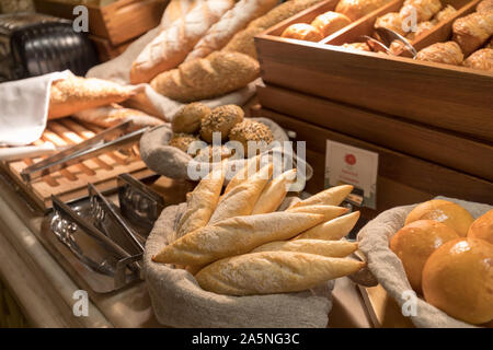 Fresh bread in luxury hotel breakfast buffet, restaurant interior - Stock Photo