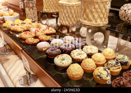 Fresh breads in luxury hotel breakfast buffet, restaurant interior - Stock Photo