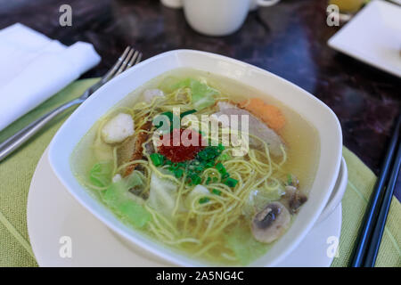 Vietnamese rice noodles in luxury hotel breakfast buffet, restaurant interior - Stock Photo