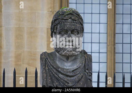 One of the carved emperor or philosopher heads around the perimeter of the Sheldonian Theatre in Oxford England each one has a different beard - Stock Photo