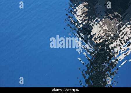 Reflections in water stored in Hoover Dam. Wind causing a pattern in water - Stock Photo