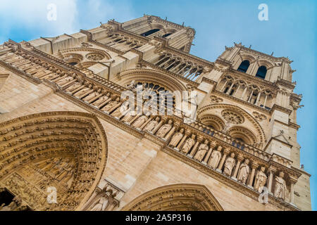 Slanted view of the famous west façade of Notre-Dame cathedral on the Île de la Cité in Paris with a close-up of the Gallery of Kings, a row of 28... - Stock Photo