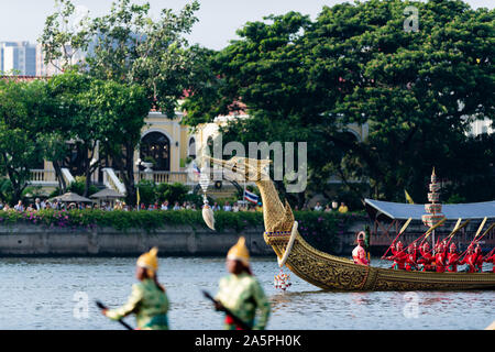 Bangkok, Thailand - October 21, 2019: Thai  royal barges participate in a procession on Bangkok's Chao Phraya River.