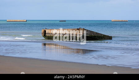 Remains of Mulberry Harbour on Gold Beach at Arromanches-les-Bains, Normandy, France - Stock Photo
