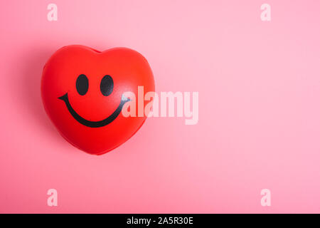 Red heart on pink background with copy space, valentine day concept - Stock Photo