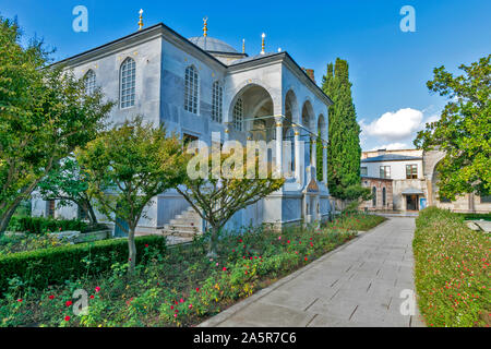TOPKAPI PALACE TURKEY  AVLU COURTYARD FLOWERBEDS AND THE GREY ENDERUN LIBRARY BUILDING