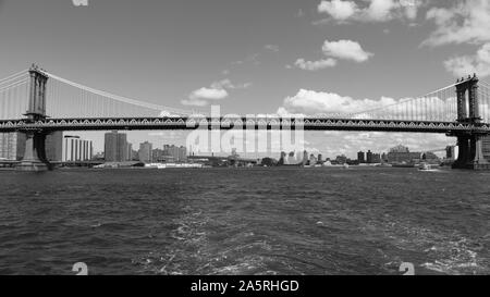 The Manhattan Bridge in New York City, which crosses the East River and links the boroughs of Manhattan and Brooklyn. - Stock Photo