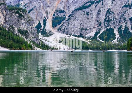 View of Lago di Braies or Pragser Wildsee (wild lake), Trentino Alto Adige (South Tirol), Dolomites mountains, Italy, row boats emerald colored lake - Stock Photo