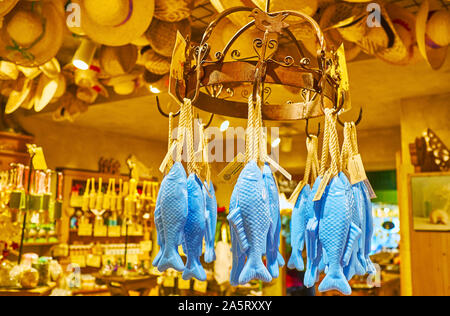 HALLSTATT, AUSTRIA - FEBRUARY 25, 2019: The blue fish shaped soap is hanging on the vintage round rack in old Salzkontor store, famous for high qualit - Stock Photo