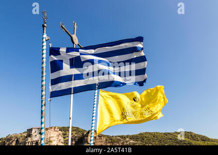 Meteora, Greece. Flags of Greek and the Greek Orthodox Church in the Monastery of Roussanou - Stock Photo