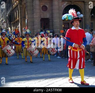 Player wearing traditional costume, followed by drummers taking part in a parade for the Calcio Storico football tournament in Florence, Italy, 2011. - Stock Photo