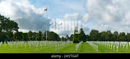 Colleville-sur-Mer, Calvados, Normandy / France - 16 August 2019: panorama view of the American Cemetery at Omaha Beach in Normandy with American flag - Stock Photo