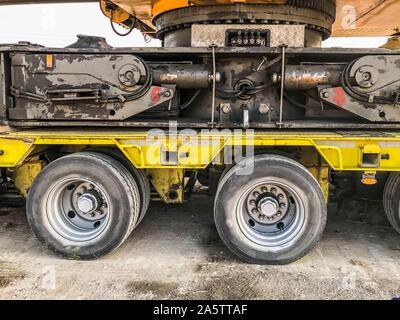 Crane loaded on large truck, transferring - Stock Photo