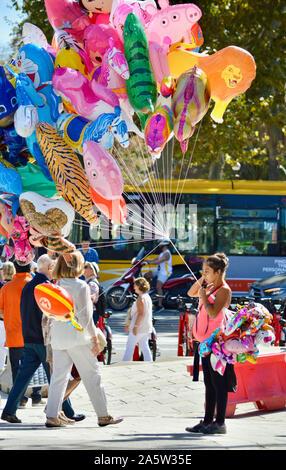 A woman holding balloons at Ciutadella Park during La Merce 2019 in Barcelona, Spain - Stock Photo