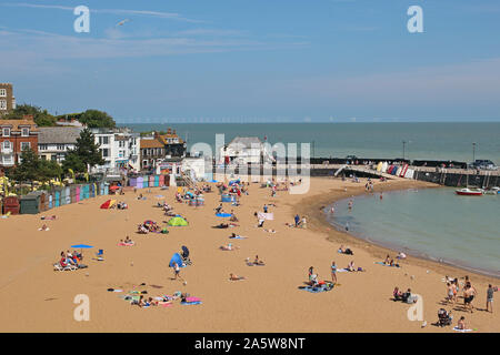 The beach at Broadstairs on the Kent coast is a welcome destination for holiday-makers on a warm and sunny summer's day. The sea is calm and inviting - Stock Photo