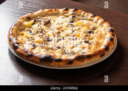 Cheap pizza with mushrooms, pineapple, and corn.