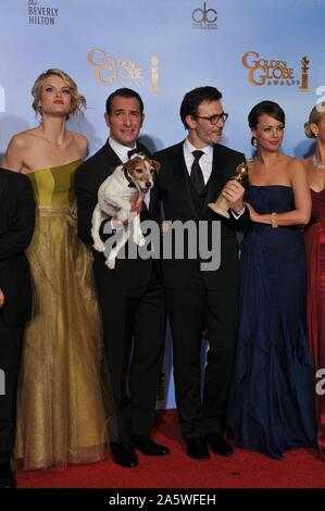 LOS ANGELES, CA. January 15, 2012: Cast of The Artist including Jean Dujardin, Berenice Bejo, Missi Pyle, director Michel Hazanavicius & Uggie the dog at the 69th Golden Globe Awards at the Beverly Hilton Hotel. © 2012 Paul Smith / Featureflash - Stock Photo