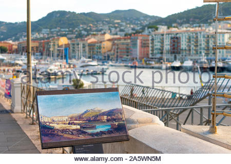 A painting on the docks and shoreline depecting historic port at the harbor of Nice, France, on the Mediterranean Sea. - Stock Photo