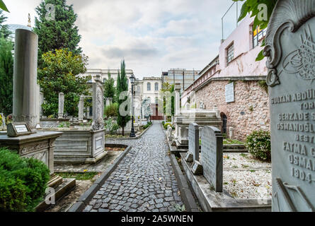 Historic interior courtyard of the Ahmet Tevfik Paşa Tomb filled with marbled headstones, graves and memorials to Turkey's rulers and sultans. - Stock Photo