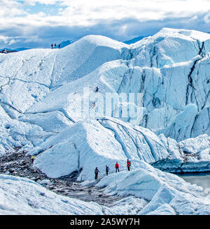 Hiking and climbing on Matanuska Glacier in Alaska. - Stock Photo