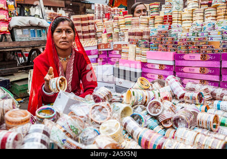 A portrait of a woman working in an open air market in Jodhpur, Rajasthan, India selling bangles. - Stock Photo