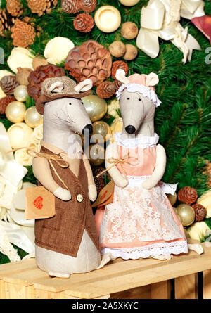 Pair of decorative toy mice dressed in a frock coat and elegant dress on the eve of the rat year. New Year celebration concept, 2020 symbol. - Stock Photo