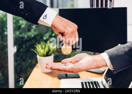 Coin bitcoin business digital money finance electronic on hand business man at office - Stock Photo