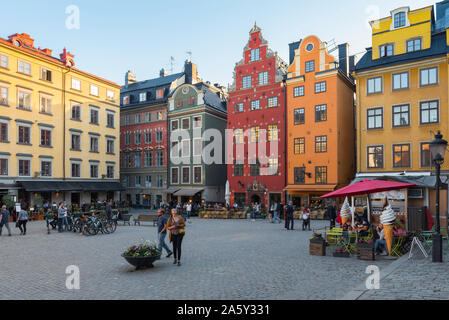 Stockholm Gamla Stan, view of a young couple walking through the market square (Stortorget) of Stockholm Old Town (Gamla Stan), Sweden. - Stock Photo