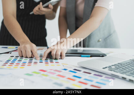 Graphic designer at work. Color swatch samples. Team designer working graphic with color chart and meeting brainstorm for new project. Graphic designe - Stock Photo