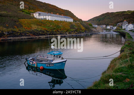 Fishing boat moored at The harbour at Boscastle Plymouth Cornwall England in evening light - Stock Photo