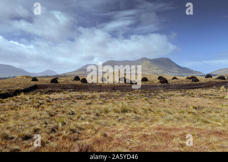 Ireland Galway,  2018 - Bogland in Ireland, with piles of turf  drying under the sun and used as fule in winter. - Stock Photo