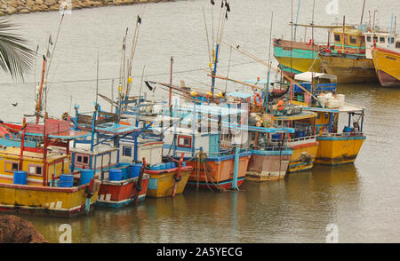 Sri Lankan traditional fishing catamarans, Colorful fishing boats docked docked in the port of Beruwala, Sri Lanka.Srilankan traditional fishing indus - Stock Photo
