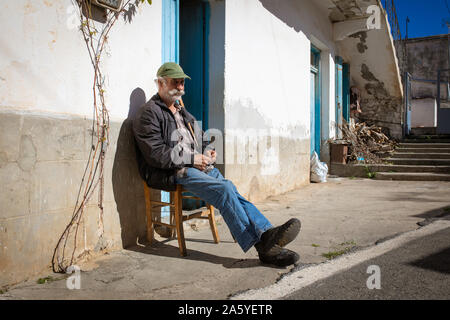 Crete / Greece - Old man holding a worry beads or komboloi. Traditional Greek hand massage tool. - Stock Photo