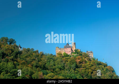Schonburg Castle at Rhine Valley or Rhine Gorge near Oberwesel, Germany, on a sunny autumn morning. - Stock Photo
