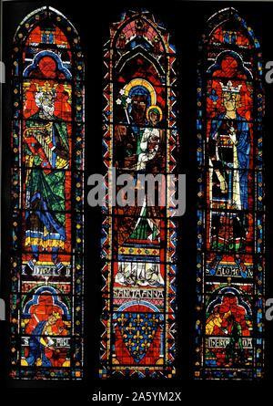 Stained glass windows from the North Transept of Chartres Cathedral, France. Shows King David with harp; St Anne with the infant Virgin Mary and King Solomon; 13th century - Stock Photo