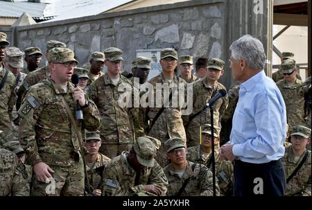 Photograph of United States Secretary of Defense Chuck Hagel (1946-) listening to a question from a U.S. soldier in Jalalabad, Afghanistan. Dated 2013 - Stock Photo