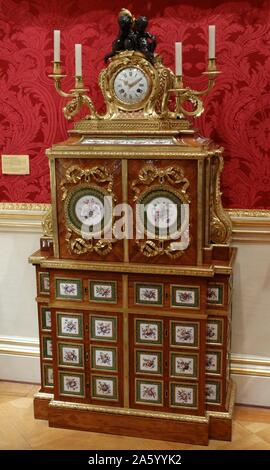 18th Century filing-cabinet and clock attributed to Jean-Francois Leleu, the clock case designed by Jean-Claude Thomas Chambellan Duplessis, the Younger and finished by Jacques-Laurent Cosson - Stock Photo