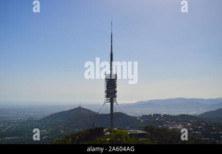 The Torre de Collserola telecommunications tower viewed from Tibidabo in Barcelona, Spain - Stock Photo