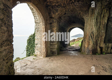 Inside Queen Adelaides Grotto, built 1826,  at the end of Earl's Drive on the Rame Peninsula. In the distance Rame Head can be seen. - Stock Photo