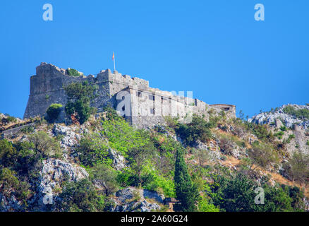 Castle Of San Giovanni on the mountain peak in Kotor town from Montenegro - Stock Photo