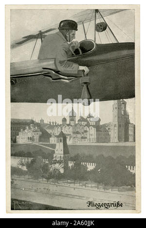 German historical postcard:  German pilot on an airplane drops a bomb on the Kremlin in Moscow, the capital of the Russian Empire, world war one 1916 - Stock Photo
