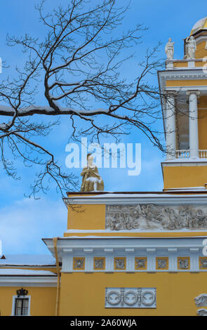 Ancient statue of a warrior-hero covered with snow framed by branches on the Admiralty building (St. Petersburg) vertical orientation - Stock Photo