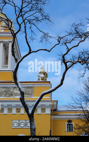 Ancient statue of a warrior covered with snow framed by arched branches on the Admiralty building (St. Petersburg) vertical orientation - Stock Photo