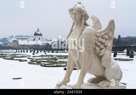 Mythological statue in the snow covered Belvedere Garten, gardens of castle housing an art museum, Vienna, Austria, Europe - Stock Photo