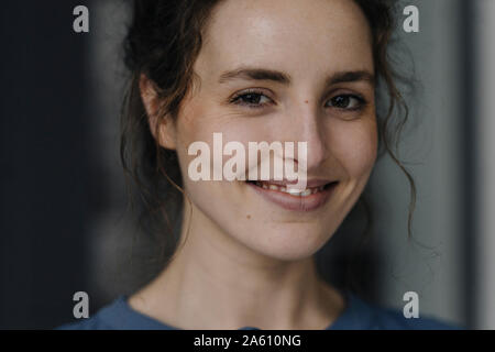 Portrait of smiling young woman with brown eyes